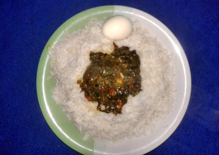 White rice and boiled egg with vegetable sauce - Laurie G Edwards