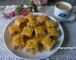 Pudín de croissants con crema de naranja