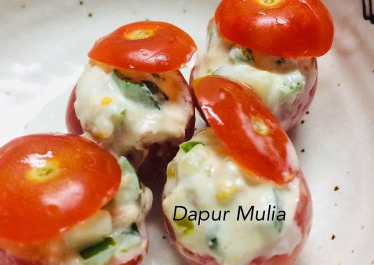 Vegetable and tuna salad in mini tomato