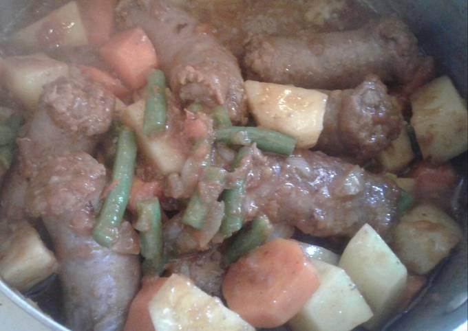 Wors in steamed veggies