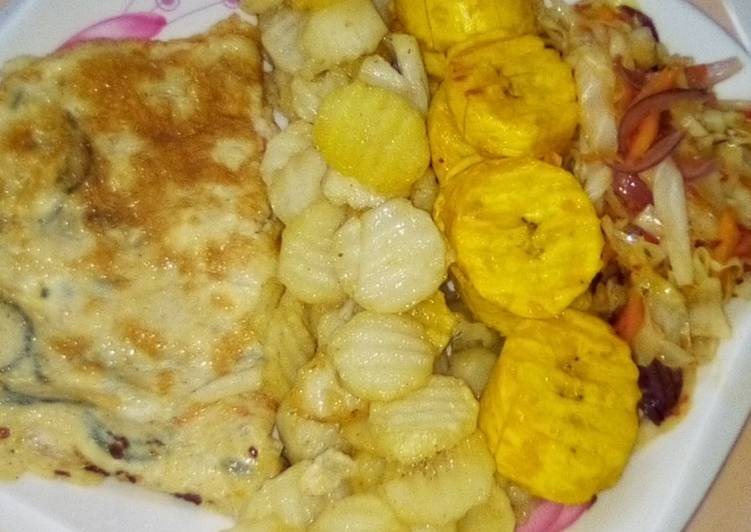Chips, plantain and fried egg with sauce