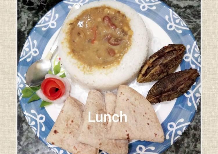 Mix Dal with Rajma boiled rice bharwa Karela chapati and salad