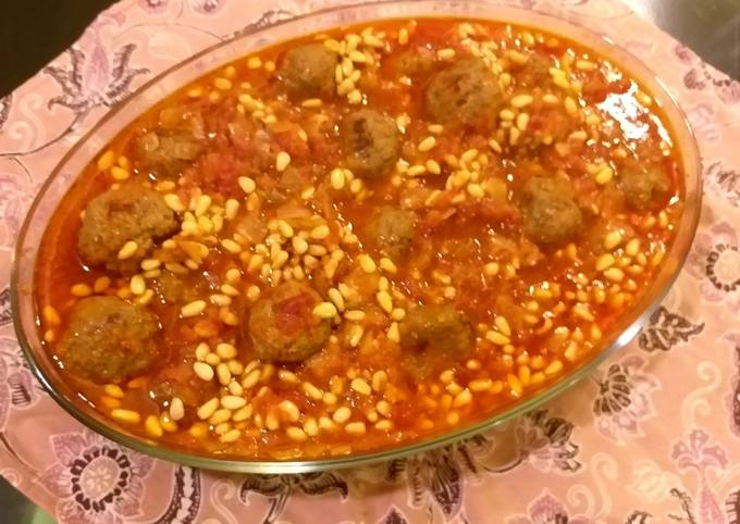 Meatballs and pine nuts in tomato sauce