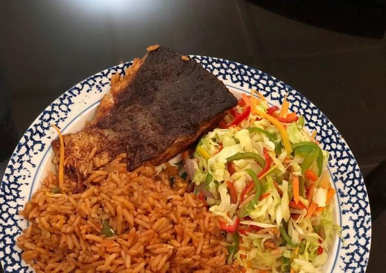 Jollof rice, fresh veggie salad with Salmon