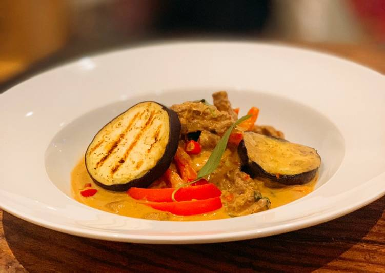 Beef and grilled aubergine red curry topped with Bird eye chillis