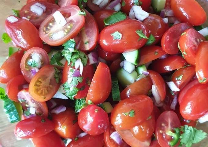 Baby plum tomato, cucumber, onion, chilli & coriander salad