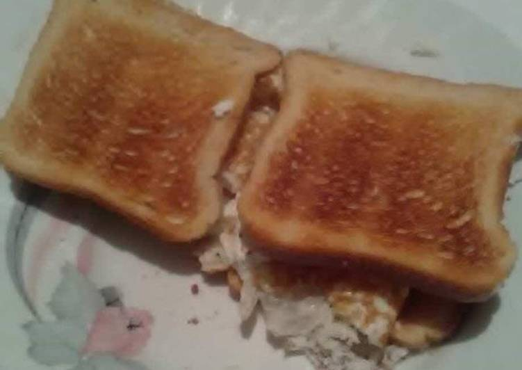 Fried white of eggs toast sandwich with white cheese ?