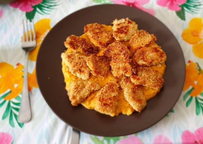 Petto di pollo al forno panato alle mandorle su crema di zucca