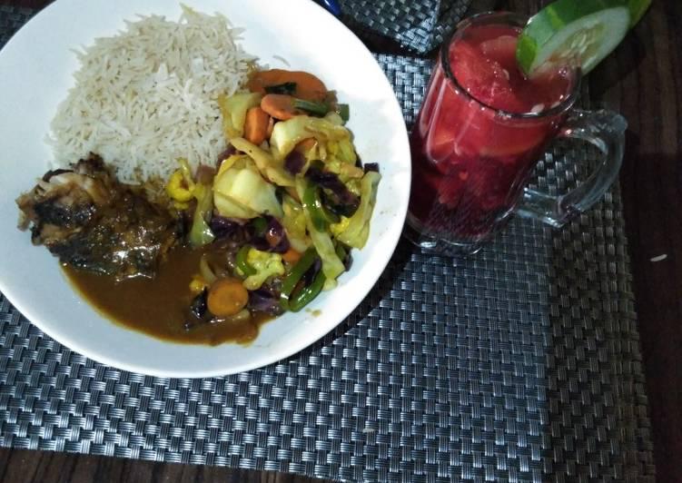 Grilled Crocker fish in Brown sauce wt Basmati Rice & Mixed Vegs