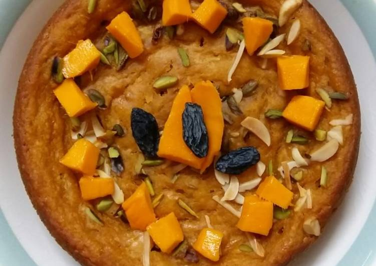 No maida Sponge cake topped with mango n dryfruit without oven