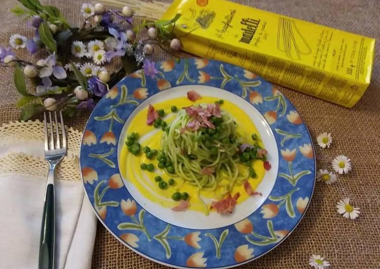 Spaghetti crema di piselli zafferano petali di prosciutto cotto