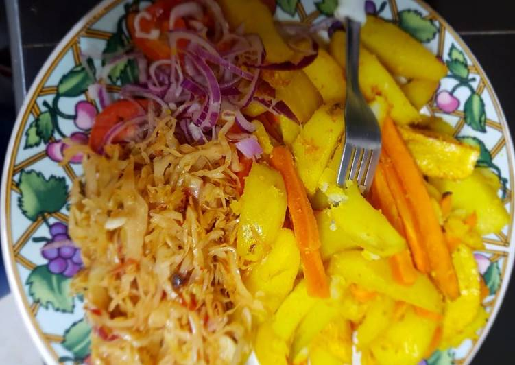 Roast potatoes, carrots served with cabbage and kachumbari