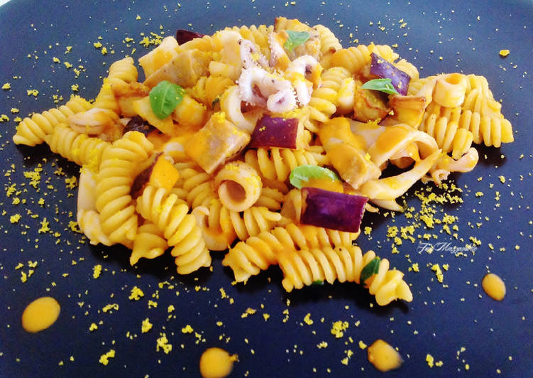Recipe: Tasty Fusilli with tuna fillet, squid, bottarga and tomato purée