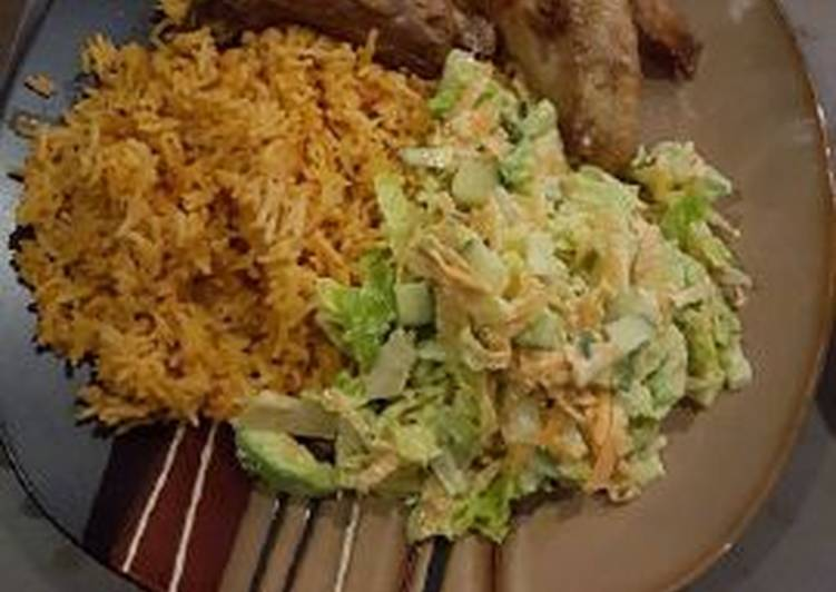 Jollof rice with salad and chicken wings