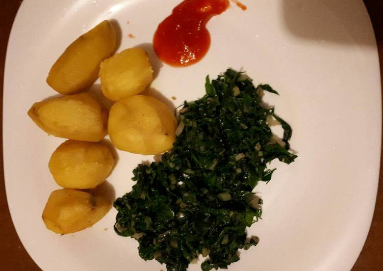 Tumeric roast potatoes served with spinach