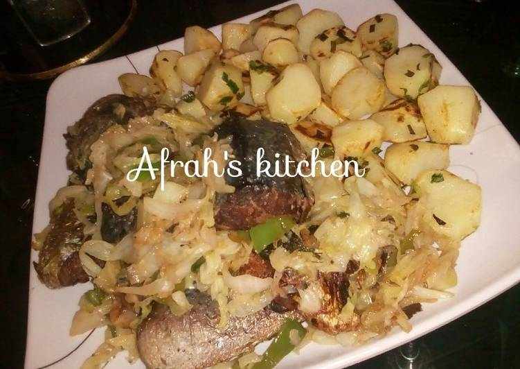 Baked potatoes and oven fish with cabbage sauce