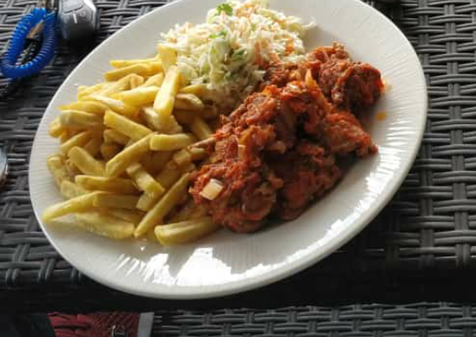 Chips,coleslaw and sauced meat
