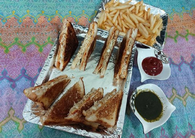 Chicken and eggs cheese sandwiches with french fries