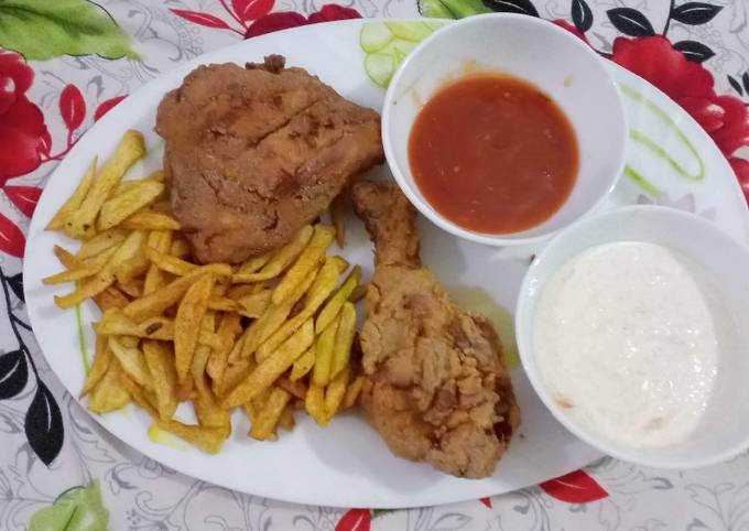 Crispy fried chicken with mayo garlic sauce ketchup and fries
