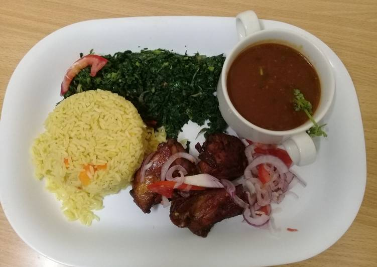 Steamed Tumeric Rice,pan grilled chicken, Fried spinach and Mixed Vegetable gravy