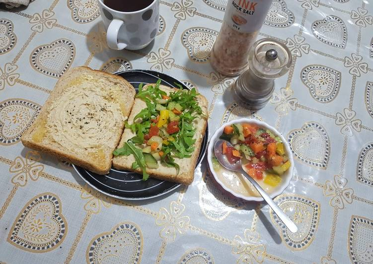 Humus sandwich with rocket and crunchy bright salad