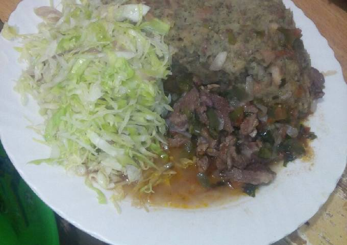 Mashed githeri with meat stew and steamed cabbage