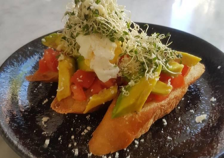 Avomato Bruschetta With Poached Egg And Alfalfa