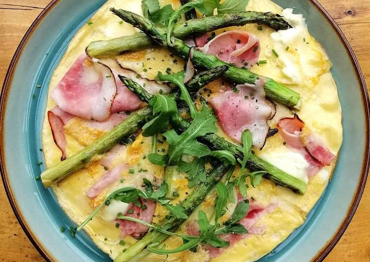 Baked omelette with ham, Langres cheese and grilled asparagus
