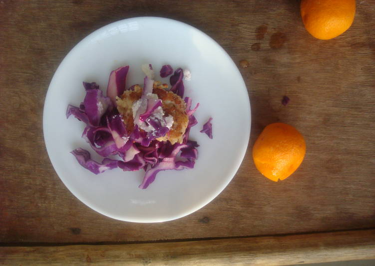 Purple cabbage salad with grilled chicken breast, feta, and citrus dressing