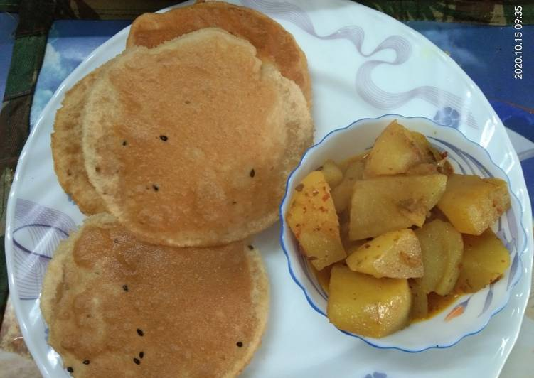 How to Prepare Award-winning Aloo Curry with Onion Seeds poori