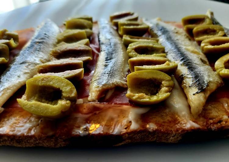 Anchovies and aioli on toast (Boquerones)