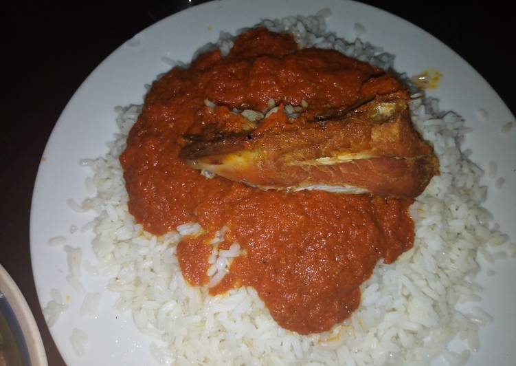 Traditional African Foods Coconut rice with chicken stew