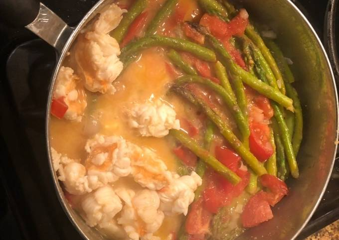 Sautéed lobster, tomatoes and asparagus with a lemon butter sauce