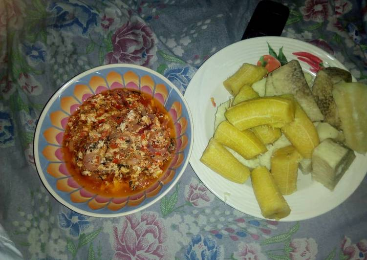 Boiled yam and plantain with egg sauce