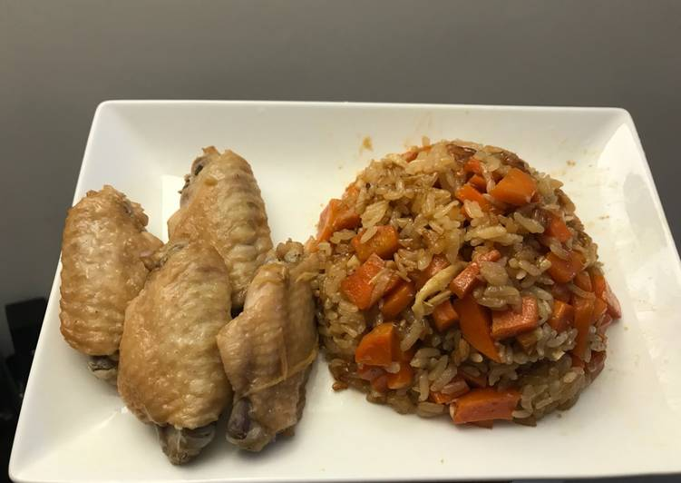 Rice with carrots and chicken wings