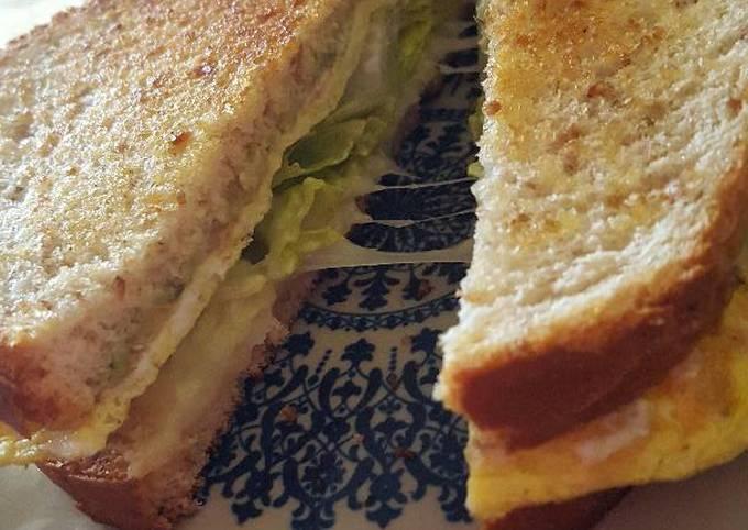 Breakfast egg cheese and avocado sandwich