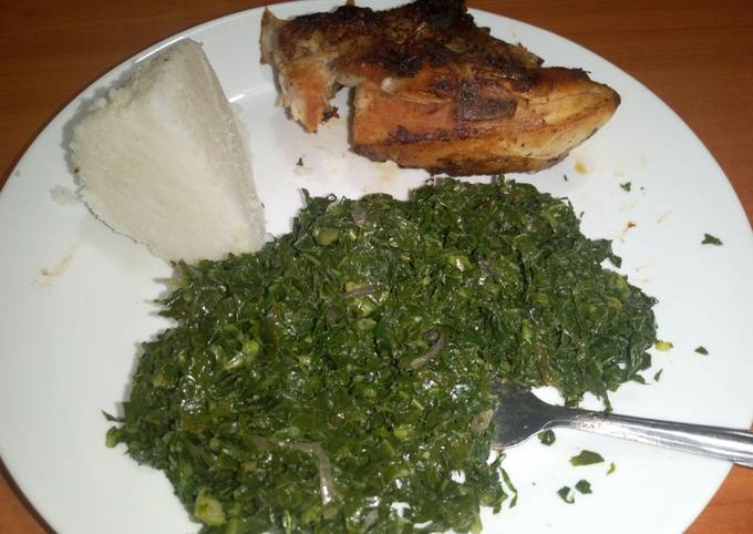 Grilled chicken served with fried kales & ugali