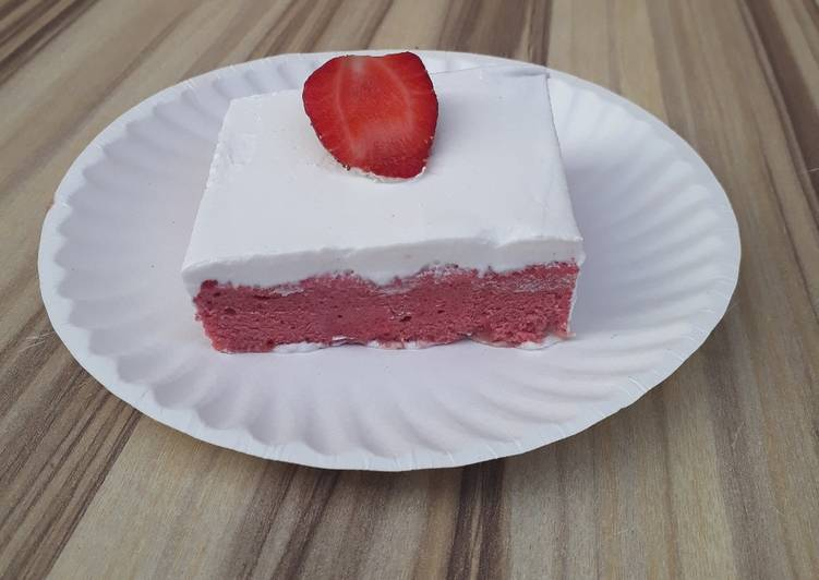 Strawberry milk cake with whipped cream frosting