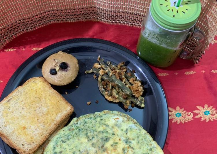English breakfast(whole wheat blueberry walnut muffin omelette airfried beans and cucumber juice)