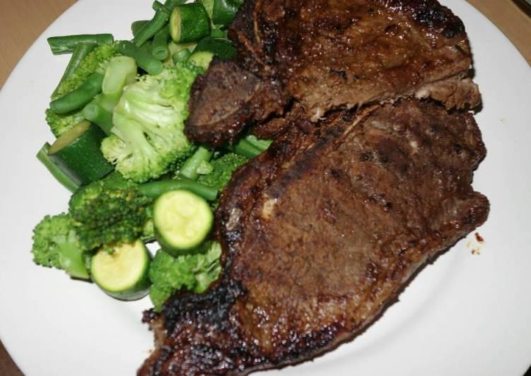 T bone steak with green vegetables