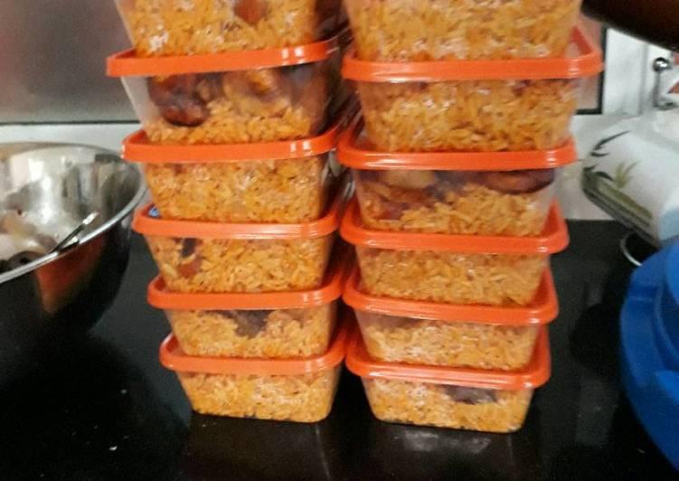 Jollof rice plantains and salad