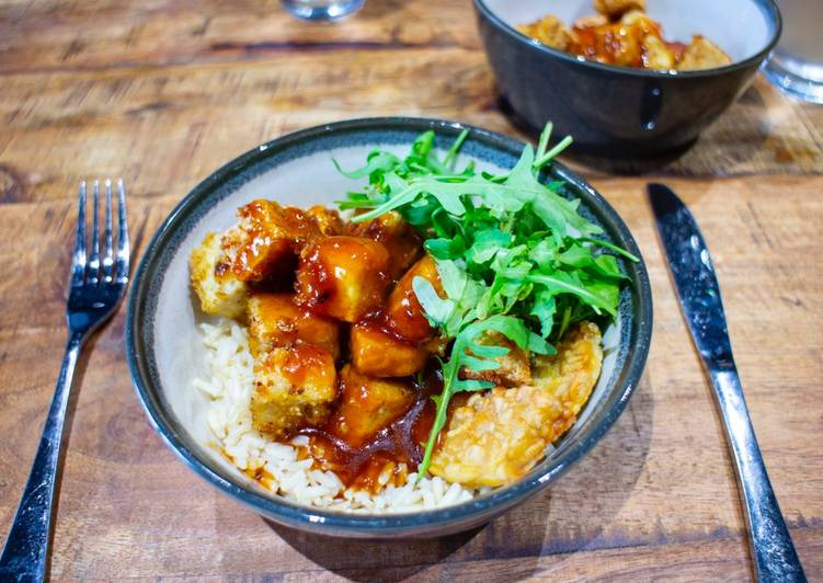 Crispy tofu top with sweet sticky and sour sauce with brown rice
