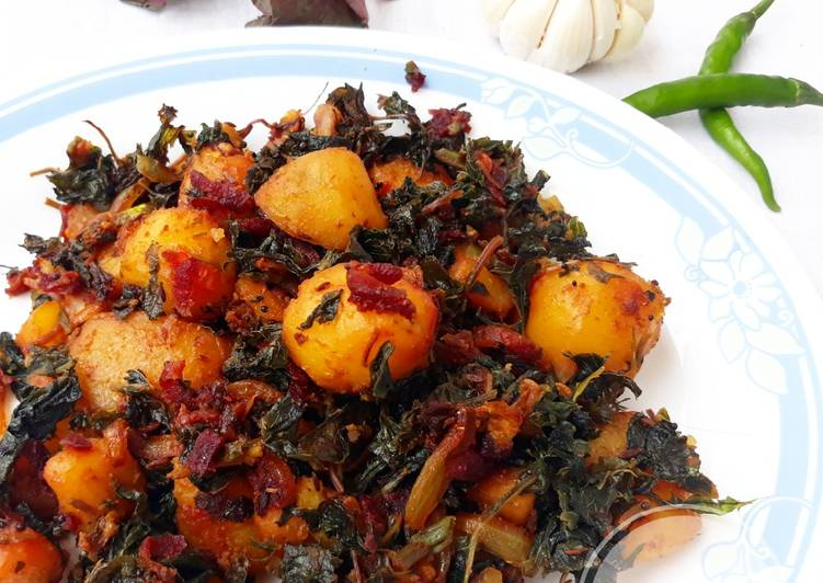 Sauteed baby potatoes with beetroot and amaranth leaves