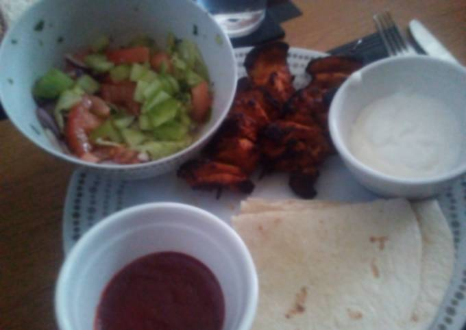 Grilled Chicken Kebabs, salad and wraps with dips