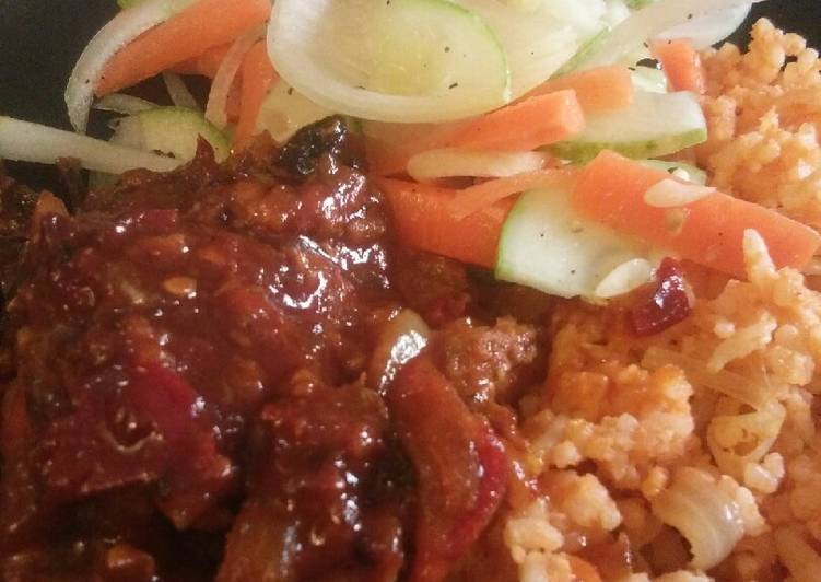 Tomato rice with chicken and salad
