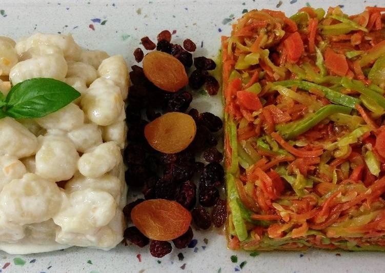 Gnocchis en leche de coco y salteado de espaguetis de verduras con anís y frutos secos