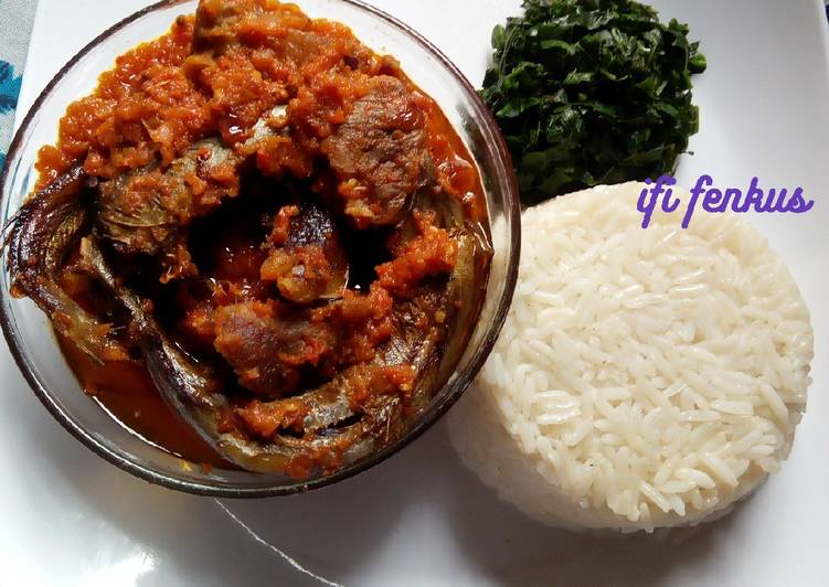 Palm oil stew paired with white rice