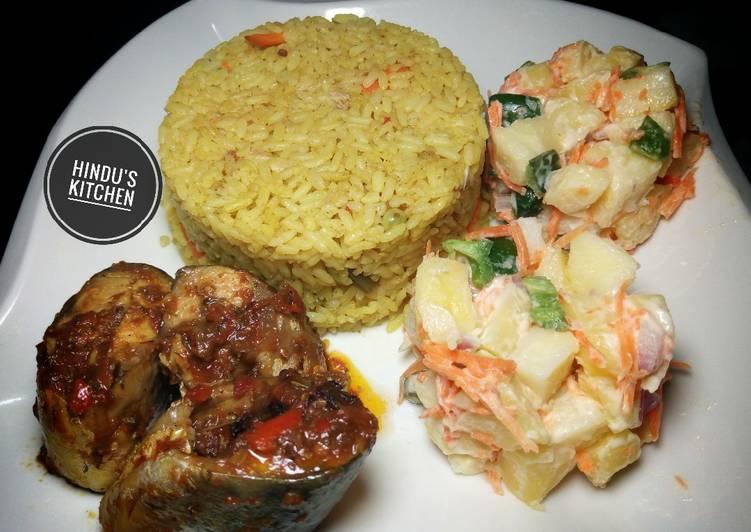 Recipe: Tasty Jollof rice, potato salad and fish