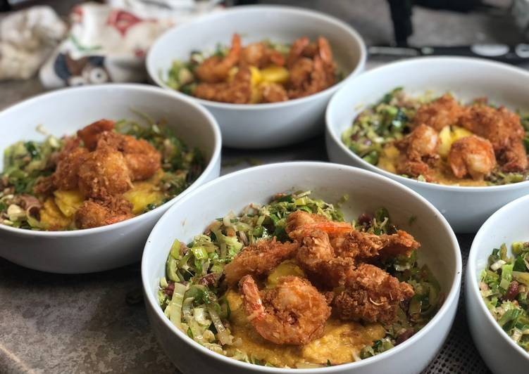 Coconut Shrimp w/ Leek Slaw over Cajun Grits