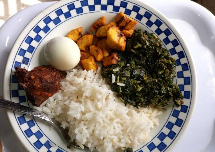 White rice with vegetable, peppered chicken, boiled egg and diced plantain